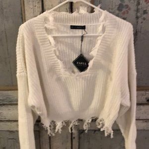 Light sweater with fraying